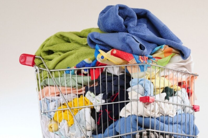 Be courteous with laundry carts — and put them back in the right place when you're done. © karammiri/iStockphoto