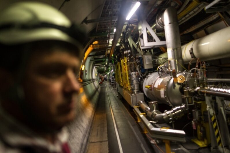 Sometimes the machine charged with facilitating head-spinning discoveries needs a little downtime. Here, a maintenance worker inspects the LHC tunnel on Nov. 19, 2013. Vladimir Simicek/isifa/Getty Images