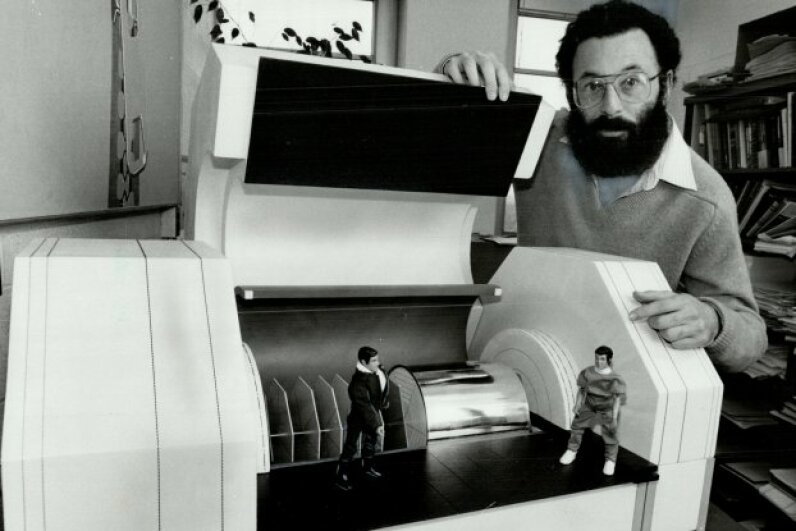 It detects quarks! The late theoretical physicist Nathan Isgur displays a model of part of a machine for observing the behavior of quarks. The price tag (back in 1981) was $83 million. Ron Bull/Toronto Star via Getty Images