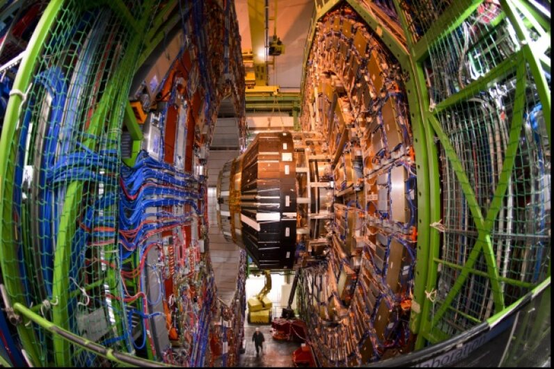 A worker stands below the Compact Muon Solenoid (CMS), a general-purpose detector at the LHC. Some physicists have had high hopes that the detector would uncover evidence to bolster SUSY. Fabrice Coffrini/AFP/Getty Images