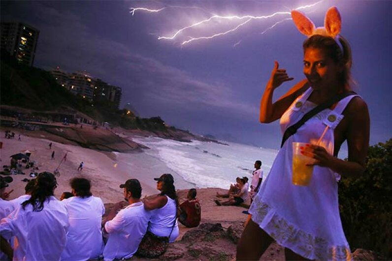 Daniela Solares walks past the camera as lightning strikes over Copacabana Beach during a Carnival festival in Brazil; she might want to take that lightning a little more seriously. Mario Tama/Getty Image