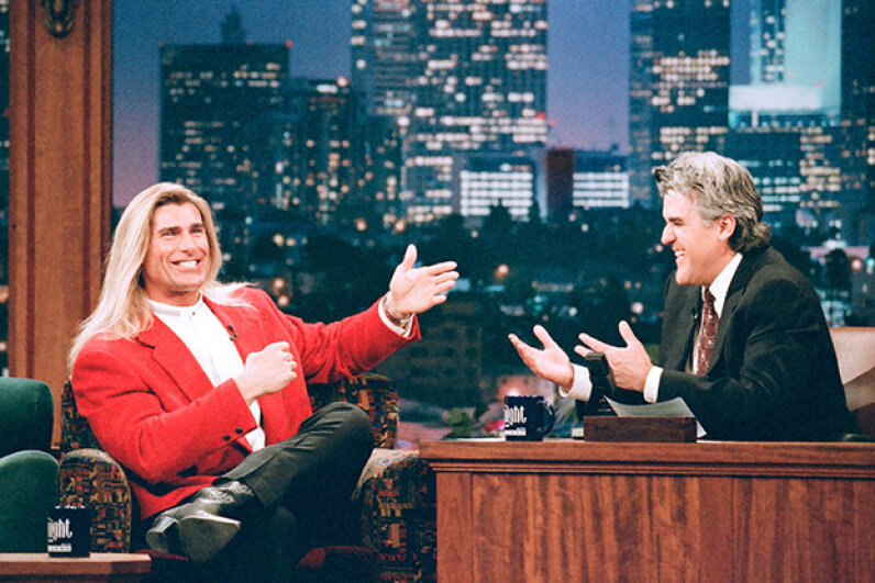 "Fabio and Jay Leno yuck it up on ""The Tonight Show,"" a couple years before Fabio's unfortunate encounter with a goose — which Leno called ""a collision between two birdbrains."" Margaret Norton/NBC/NBCU Photo Bank via Getty Images"