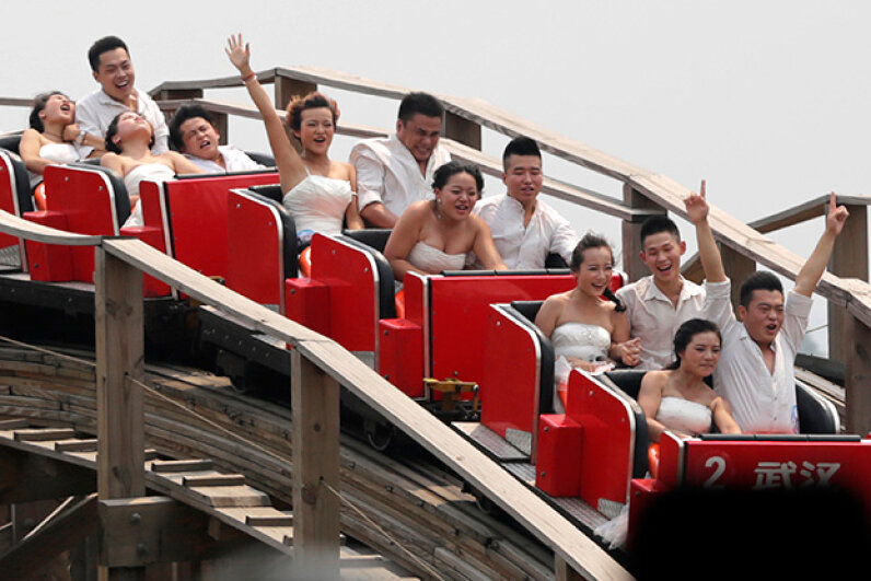 Newly married couples ride a roller coaster during their wedding ceremony at the Happy Valley theme park in Wuhan, China. Some couples enjoyed the ride more than others. STR/AFP/Getty Images