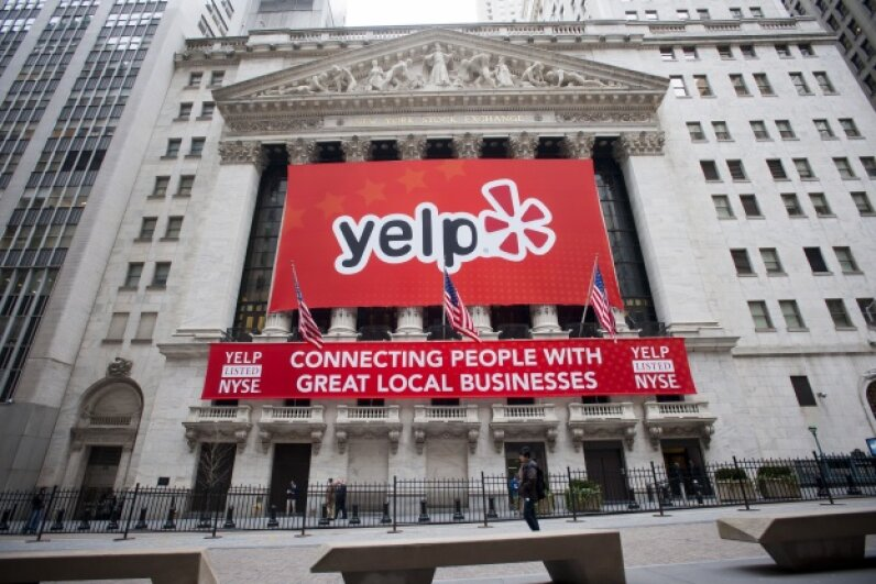 Positive reviews on Yelp can help attract customers to your business. © Richard Levine/Demotix/Corbis