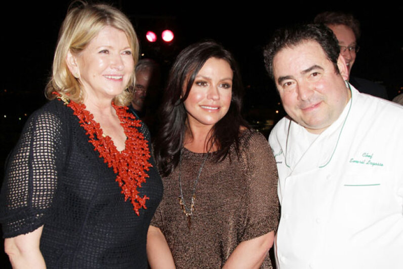 Martha Stewart, Rachael Ray and Emeril Lagasse, pictured together in 2011, all hosted televisions shows that influenced contemporary home cooking. Alexander Tamargo/Getty Images