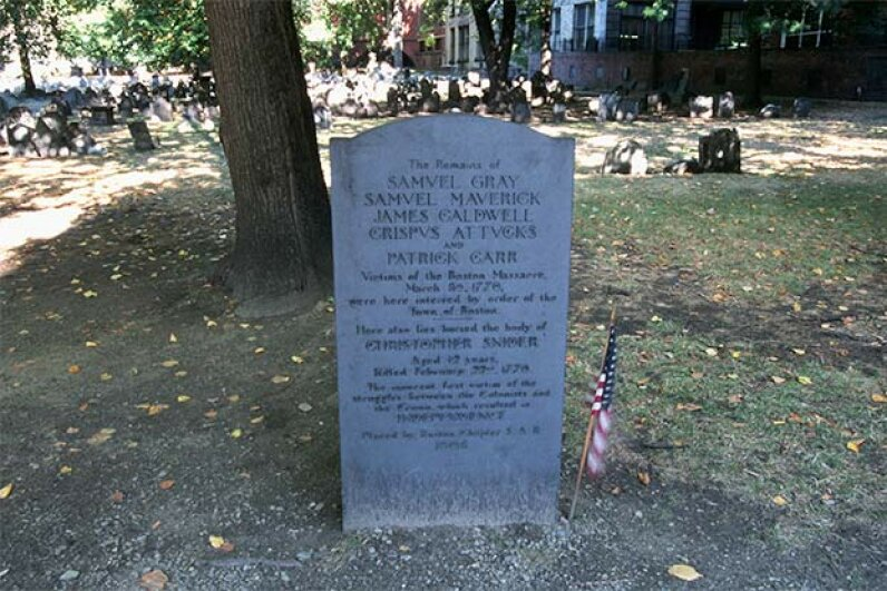 This gravestone marking the Boston Massacre lists the names of the five people who were killed. See Revolutionary War pictures. © Kevin Fleming/Corbis