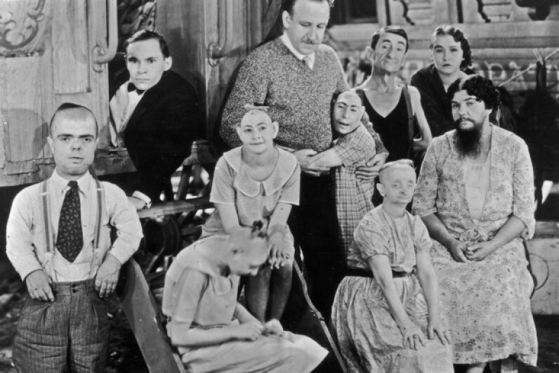 "Often, sideshows paraded mental disabilities as acts. Here, director Tod Browning poses with the cast of his circus film, ""Freaks."" Hulton Archive/Archive Photos/Getty Images"
