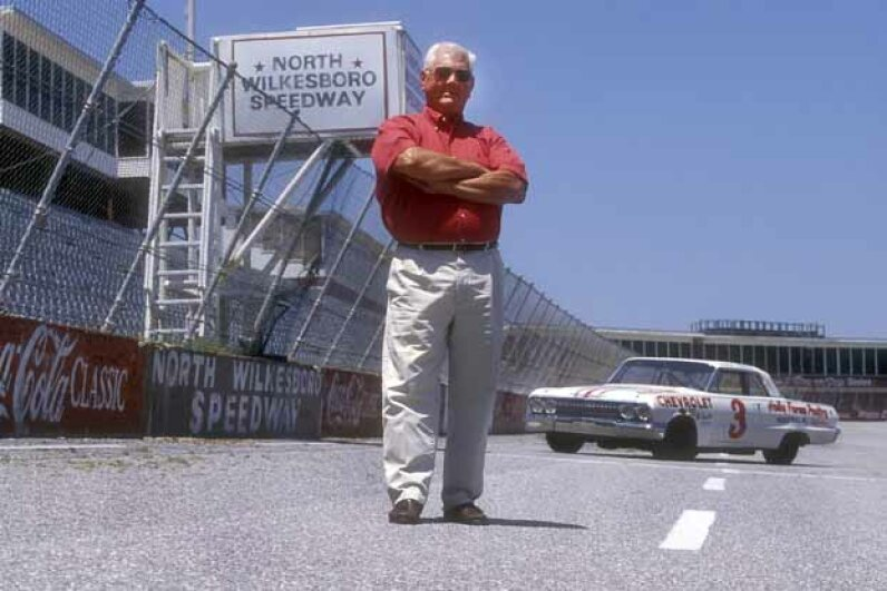 NASCAR legend Junior Johnson with his 427 Mystery Motor Chevrolet. Johnson started out as a bootlegger before making it big in NASCAR. © Martyn Goddard/Corbis
