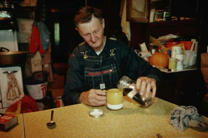 An experienced moonshiner can check the alcohol content of his brew by giving the jar a good shake and seeing how large the bubbles are. © Richard A. Cooke/CORBIS
