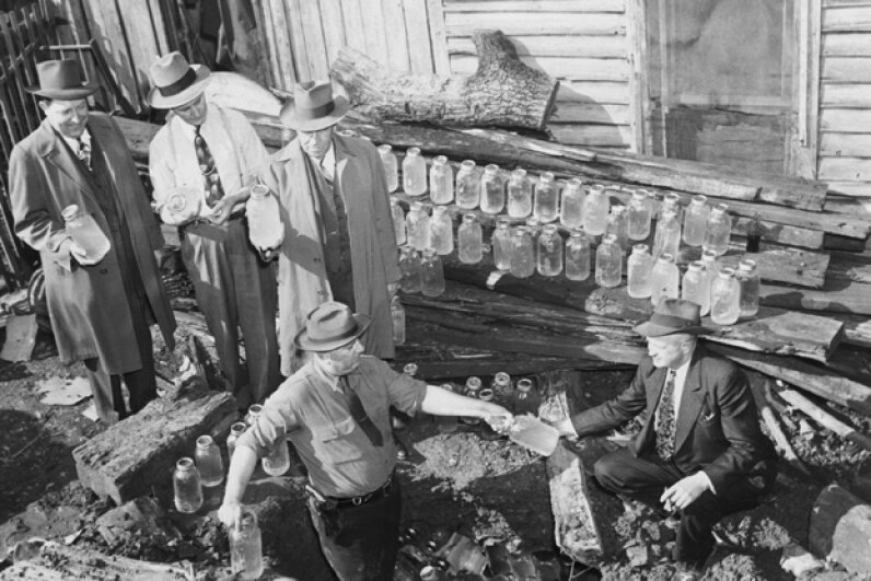 State agents found 75 gallons of contraband whiskey hidden under a tree stump in Atlanta in 1944. © Bettmann/CORBIS