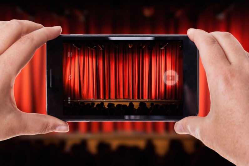 To compete with the easy availability of streaming entertainment at home and in the pockets of consumers, theaters will need to find new ways to engage audiences. ©Dario Lo Presti/iStockphoto