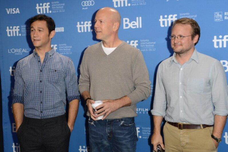 """Joseph Gordon-Levitt, Bruce Willis and writer/director Rian Johnson promoting """"Looper"""" at the 2012 Toronto International Film Festival  © Jason Merritt/Getty Images"""