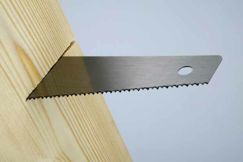 You should own two types of saws: A crosscut saw cuts against the wood grain while a ripsaw cuts parallel to the grain. Fuse/Thinkstock