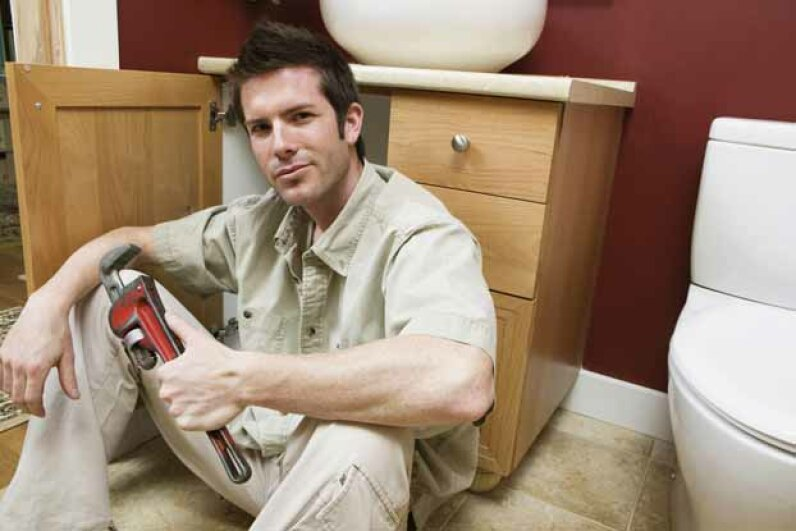 A pipe wrench is good for plumbing jobs as it can tighten and loosen pipes. Purestock/Thinkstock