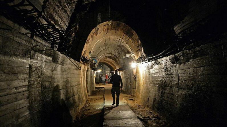 Men walk in underground galleries under the Ksiaz castle, Poland, in the area where the 'Nazi Gold Train' is supposedly hidden underground, on Aug. 28, 2015. JANEK SKARZYNSKI/AFP/Getty Images