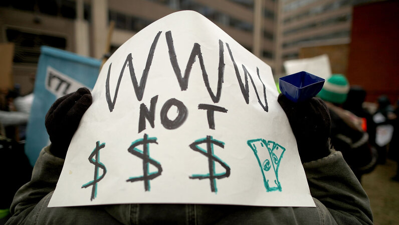 Demonstrator protesting net neutrality rules being overturned