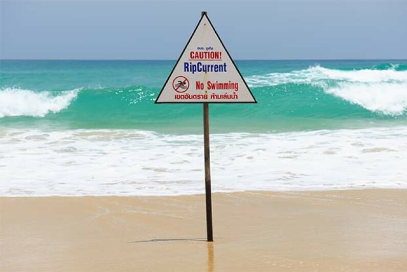 Rather than swimming toward shore if you're caught in a rip current, swim parallel to shore until you bypass the current. Zoonar/N.Okhitin/Thinkstock
