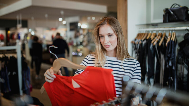 Woman browsing in clothes story