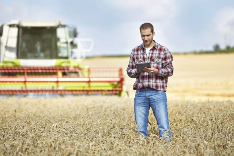Modern crop management involves handling specialized data to maximize output. © pablo_rodriguez1/iStock/Thinkstock