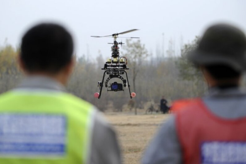 A demonstration event in China's Ningxia Hui Autonomous Region in October 2012 showed off the ability of UAVs to monitor agriculture, forestry, land resources and water resources. © Wang Peng/Xinhua Press/Corbis