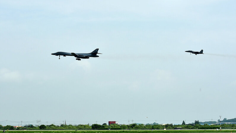 A U.S. Air Force B-1B Lancer bomber (L) flies with a South Korean F-15K fighter jet over the Korean Peninsula after North Korea's ICBM test on July 30, 2017. South Korean Defense Ministry via Getty Images