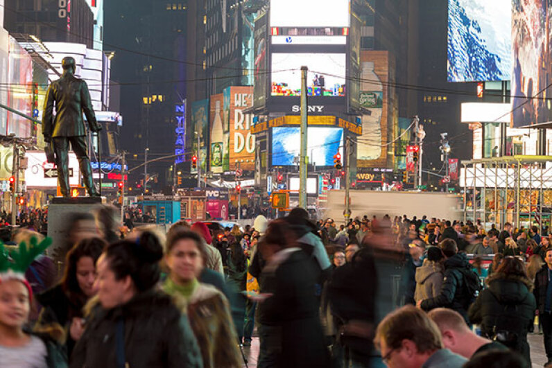 People flock to Times Square, New York City, for the New Year's Eve celebration. Yelling 'fire' in a place like this would probably not be protected by the First Amendment. Unless it were true. Pola Damonte via Getty Images