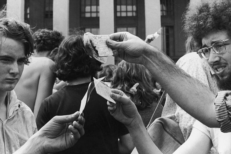 Antiwar demonstrators burn their draft cards on the steps of the Pentagon in Washington, D.C. during the Vietnam War. The Supreme Court ruled that burn a draft card is not protected speech. Hulton Archive/Getty Images