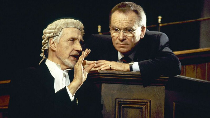 """The actors Jeffrey Archer and Edward Petherbridge act in a 2000 stage production of """"The Accused."""" Graham Wiltshire/Getty Images"""