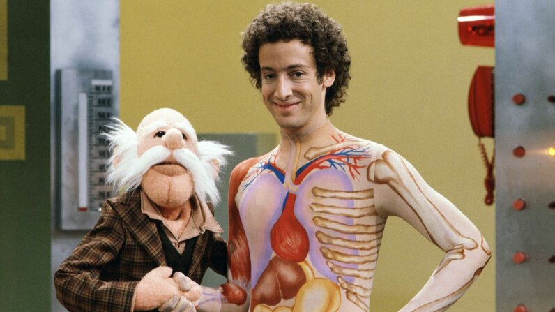 "Slim Goodbody (John Burstein) poses with the puppet Inspector Thiamin on ""Captain Kangaroo"" CBS via Getty Images"