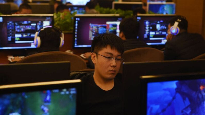 Men play games on computers in an internet bar in Beijing. 'Freedom and order' are both necessary in cyberspace, Chinese President Xi Jinping said on Dec. 16, 2015, as he opened a government-organised internet conference condemned by campaigners as an ... GREG BAKER/AFP/Getty Images