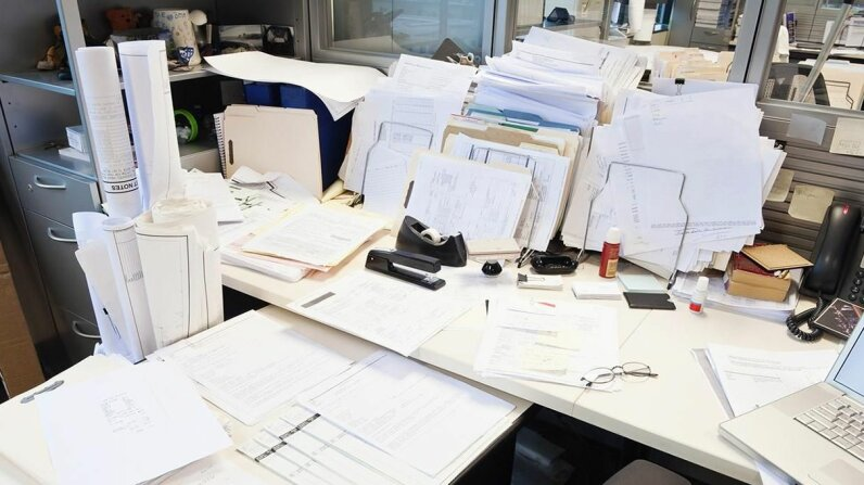Is your cluttered desk a sign of creative genius or total chaos? Experts weigh in. Jetta Productions/Getty Images
