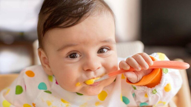 Giving your baby peanuts and eggs can actually lessen the risk of him getting these allergies. Anna Pekunova/Getty Images