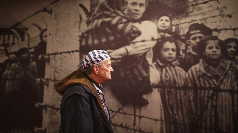 Holocaust survivor Igor Malicky, 90, pauses as he tours an exhibition inside the former German death camp Auschwitz ahead of commemorations in 2015 marking the 70th anniversary of the camp's liberation. Christopher Furlong/Getty Images