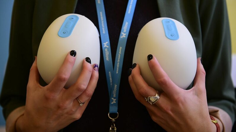 A woman holds the Willow breast pump at CES 2017. Frederic J. Brown/AFP/Getty Images