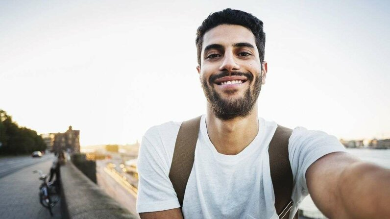 New research indicates that habitual selfie-takers may increase their self-favoring bias, affecting how they view photos of themselves. Maskot/Getty Images