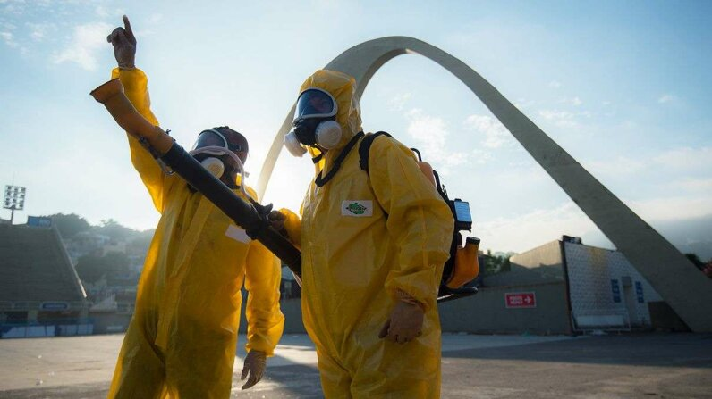 Public health workers fumigate stadiums in Rio de Janeiro in January 2016 to prepare for Carnaval celebrations. Christopher Simon/AFP/Getty Images