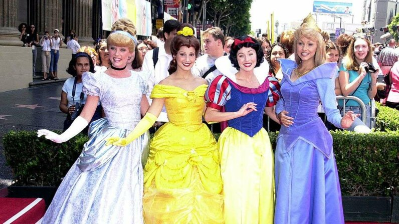 "Disney princess characters pose during ""The Princess Diaries"" premiere at El Capitan Theatre in Hollywood, California. SGranitz/WireImage/Getty Images"