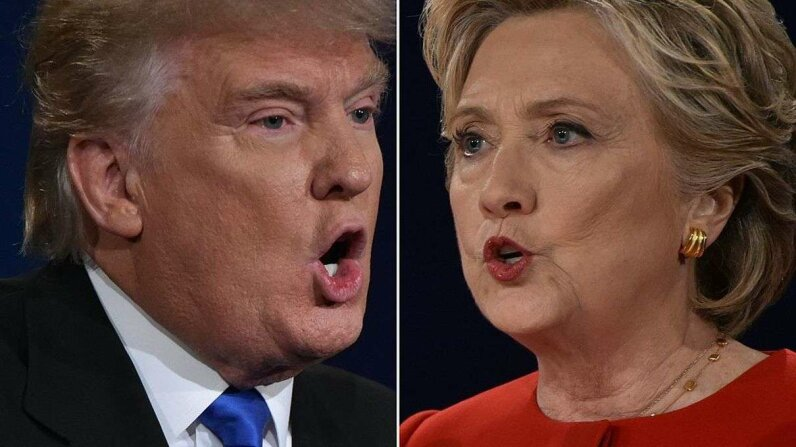 publican nominee Donald Trump and Democratic nominee Hillary Clinton face off during the first presidential debate at Hofstra University in Hempstead, New York. / PAUL J. RICHARDS/AFP/Getty Images