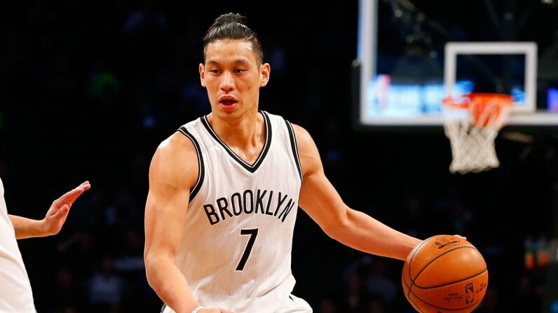 "Jeremy Lin ignited ""Linsanity"" in 2012 when he led the New York Knicks to a winning turnaround. Lin remains one of the few Asian-American NBA players and is now with the Brooklyn Nets. Jim McIsaac/Getty Images"