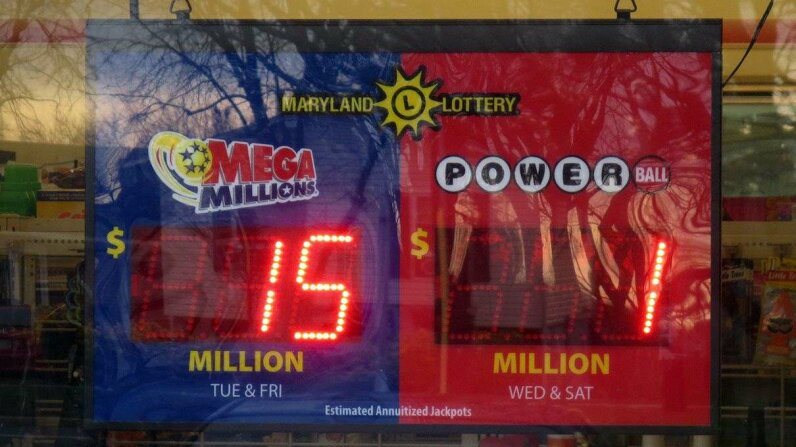 "As the multi-state Powerball lottery jackpot has reached a record level of $1.5 billion the value has exceeded the limit of signs such as this one in Greenbelt, Maryland, causing them to ""rollover"" to showing $1 million instead. (c) Evan Golub/Demotix/Corbis"