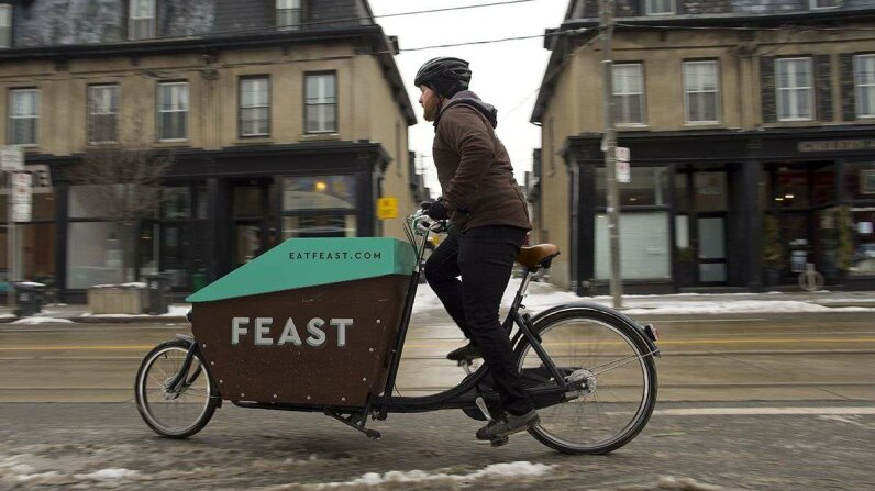 Some enterprising culinary types are opting for the less expensive food bike instead of the food truck. Lucas Oleniuk/Toronto Star via Getty Images