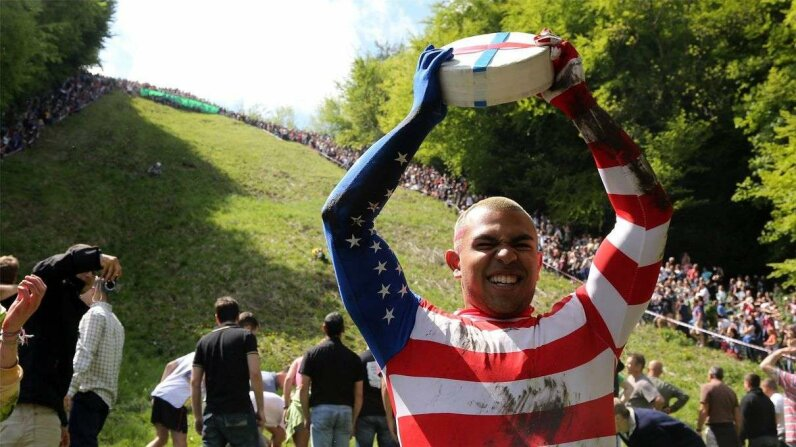 Colorado Springs-based American Kenny Rackers celebrates winning the first race at Cooper's Hill during the annual tradition of cheese rolling on May 27, 2013, in Brockworth, Gloucestershire, England. Matt Cardy/Getty Images