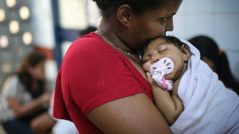Grandmother Ivalda Caetano holds Ludmilla Hadassa Dias de Vasconcelos (2 months), who has microcephaly, at Oswald Cruz hospital on Jan. 26, 2016, in Recife, Brazil. The World Health Organization said on Feb. 1 that a causal relationship between Zika vi... Mario Tama/Getty Images