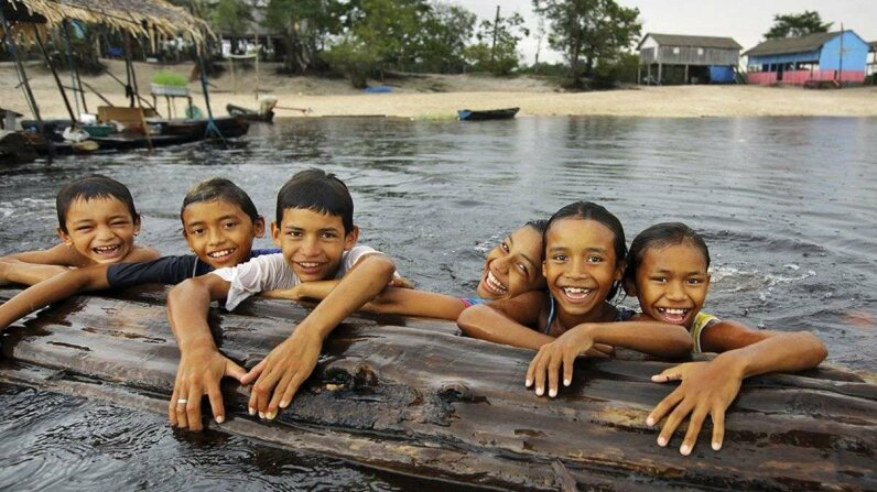Amazonian children play in the Rio Negro in the northwestern part of Brazil where Nheengatu is spoken. Timothy Allen/Getty Images