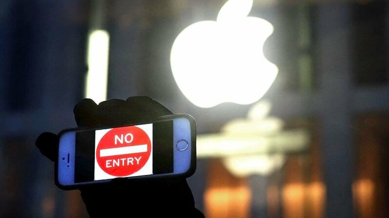 A man holds up an iPhone displaying a 'No Entry' image as part of a rally in front of an Apple Store in support of the company's privacy policy. Ultimately, the FBI unlocked the San Bernardino terrorists phone without help from Apple. Jewel Samad/AFP/Getty