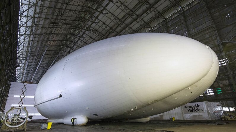 The Airlander aircraft hangs out in a giant shed on Feb. 28, 2014, in Cardington, England. Although slow moving compared to conventional aircraft, the Airlander is able to carry large payloads. Oli Scarff/Getty Images