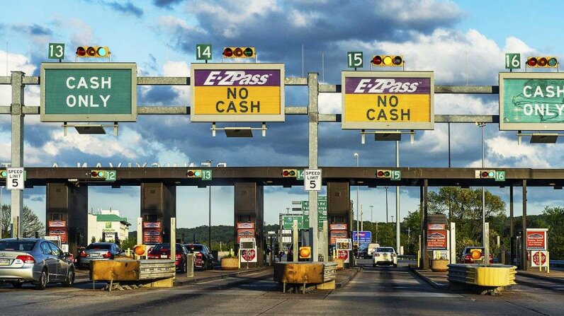 As more toll roads move away from cash, where does that leave drivers who don't have electronic passes? John Greim/LightRocket/Getty Images
