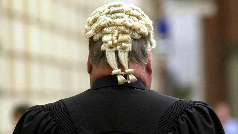 Some lawyers still uphold the practice of wearing white powdered wigs in court. NICOLAS ASFOURI/AFP/Getty Images