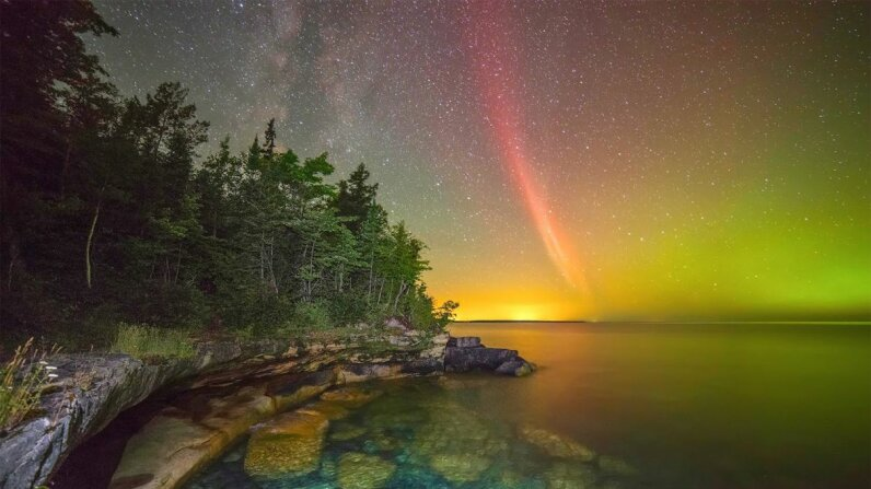 "This photo showcases what's thought to be a proton arc over Lake Superior. Proton arcs, however, typically are not visible. Might they actually be a new and mysterious phenomenon called ""Steve"" instead? Ken Williams/NOAA Weather in Focus Photo Contest 2015"