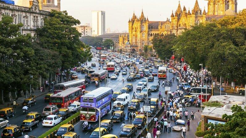 Traffic moves around the Chhatrapati Shivaji Terminus train station in Mumbai, India. Peter Adams/Getty Images